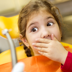 scared child looking at dental tool 4