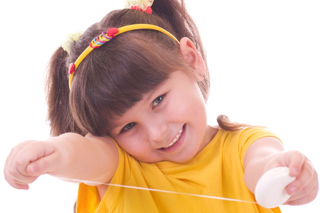 smiling child taking out dental floss