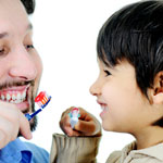 father and son brushing their teeth together 4
