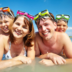 family of four wearing goggles 4