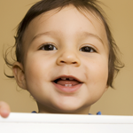 infant smiling showing new baby teeth - Toddler Dentist in Katy, TX