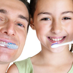 father and daughter brushing teeth 4