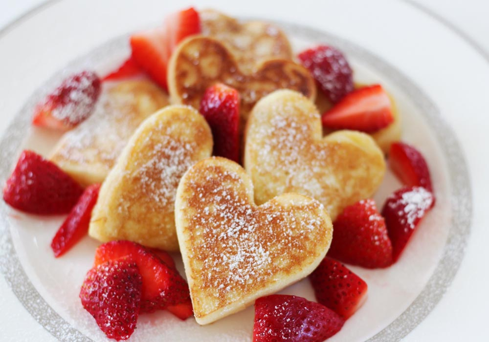 heart shaped pancakes with strawberries