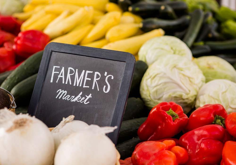 farmers market sign in vegetables