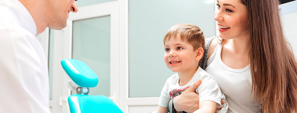 parent and child meeting their dentist - Pediatric Dentist in Katy