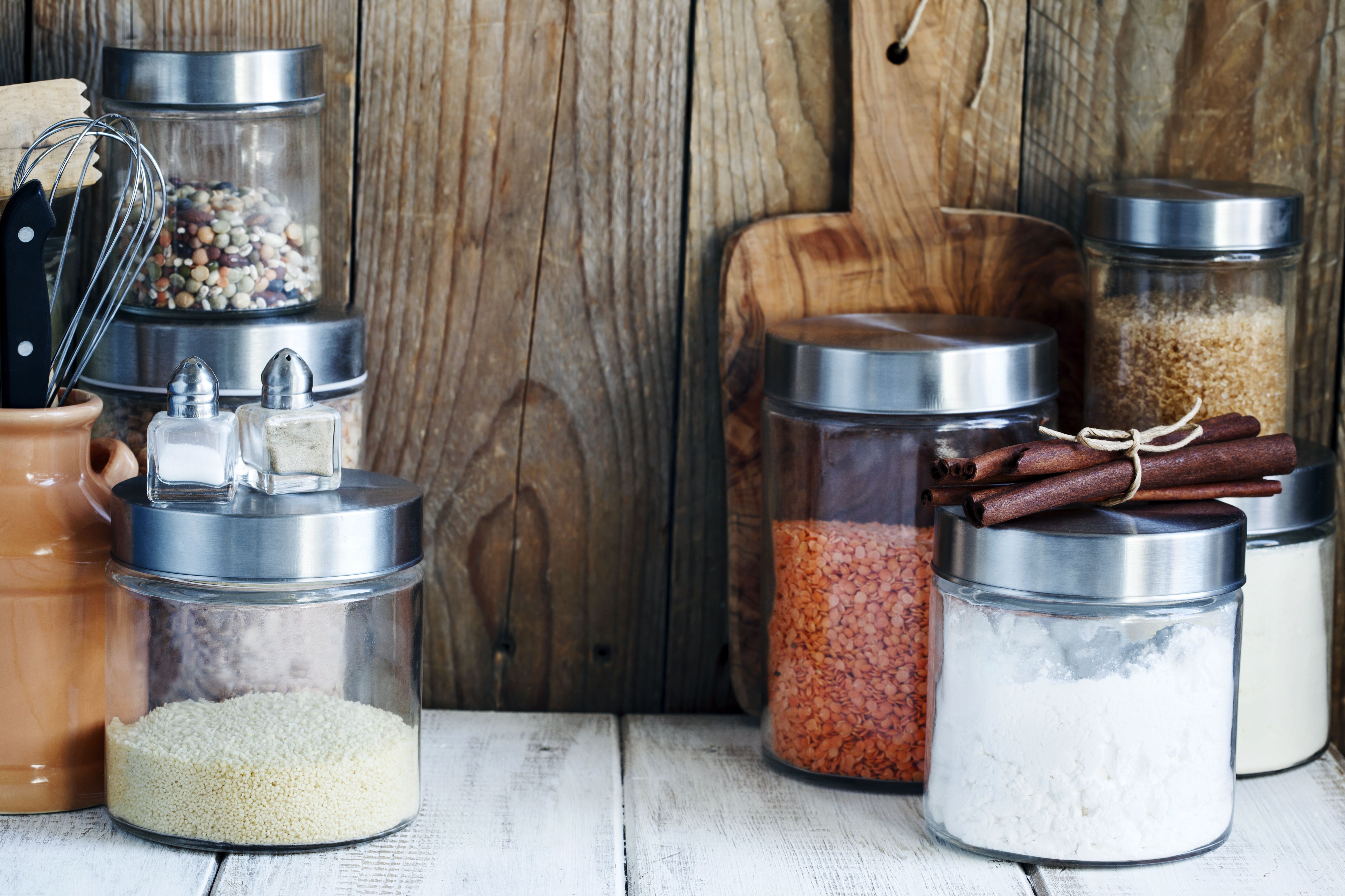 photo of Arrangement of dry food products and kitchen utensils in the kitchen. Home kitchen rustic still life