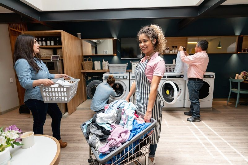Portrait-of-beautiful-woman-working-at-a-laundromat-cm