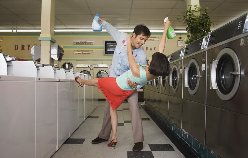 Couple-dancing-with-soap-in-launderette-cm
