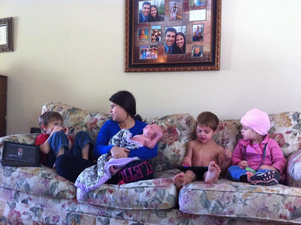Watching General Conference on the couch with our four children including our newborn