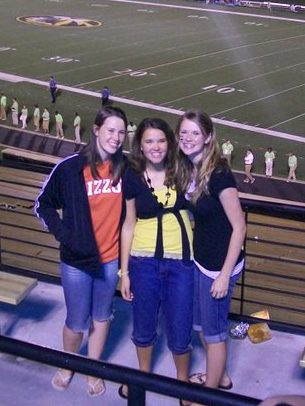 Three sisters attend football game