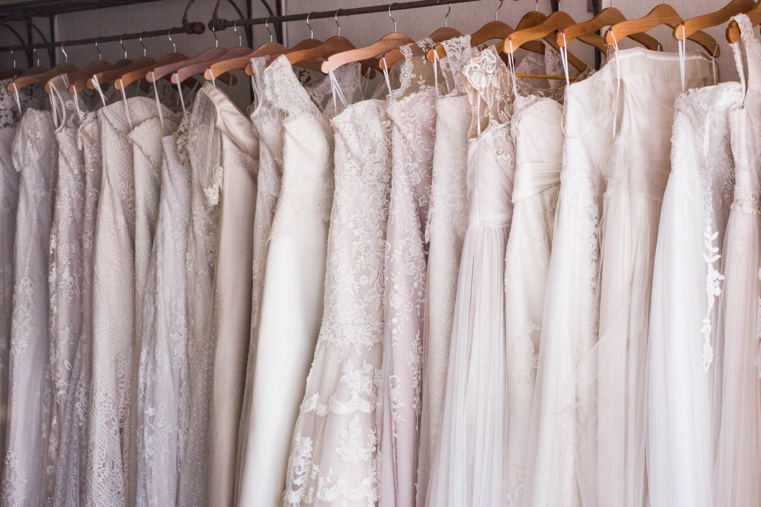 Beautiful dresses neatly hung in a closet