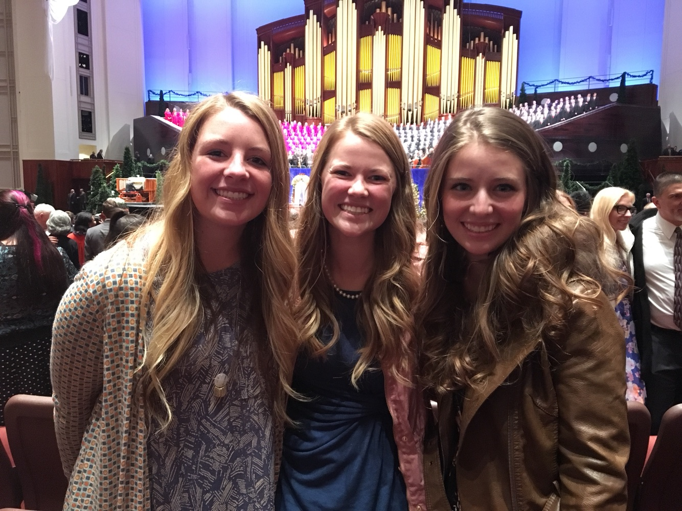 Makayla with her missionary companions at the First Presidency Christmas Devotional