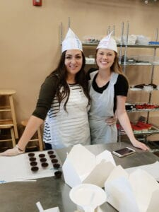 Tara and Makayla in their chocolatier garb at Just Add Chocolate