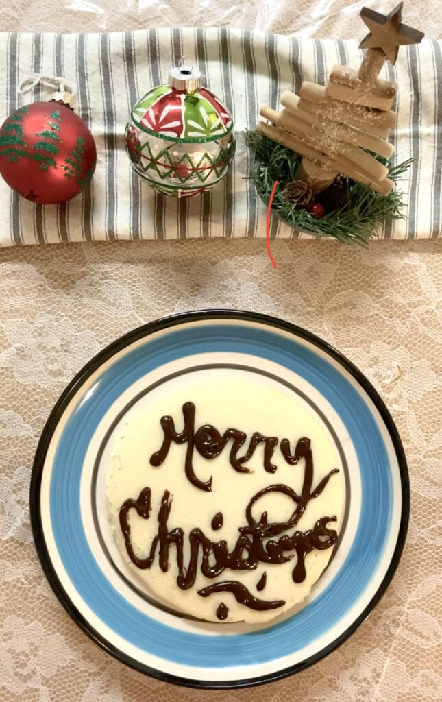 A pancake with Merry Christmas written in chocolate syrup
