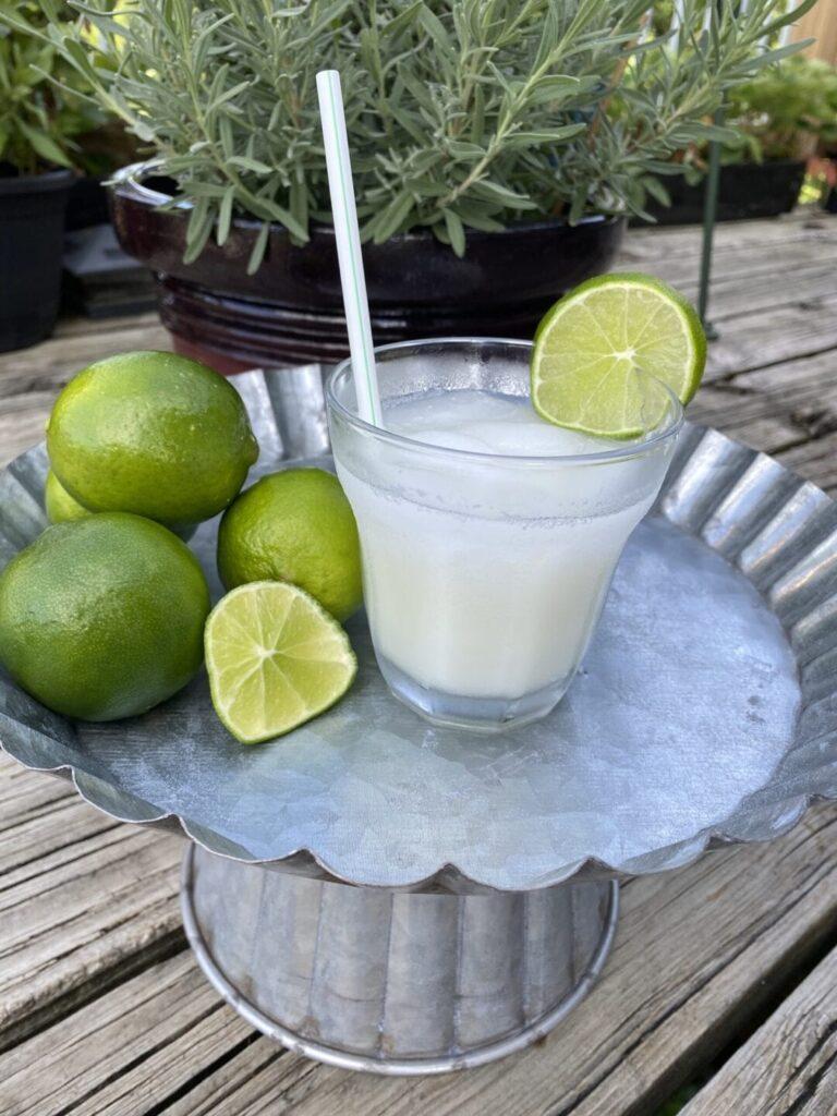 Brazilian lemonade with limes on table