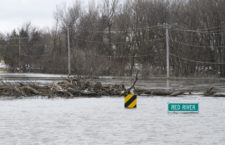 Moorhead, MN, April 4, 2009 -- The Red River drowns the roadway and completely covers over a bridge just north of Moorhead, MN. According to local officials, the 2009 spring flood of the river was the highest ever recorded. Mike Moore/FEMA