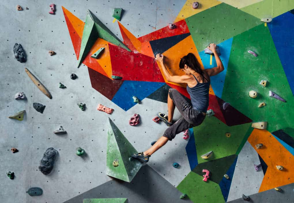 girl climbing on the wall