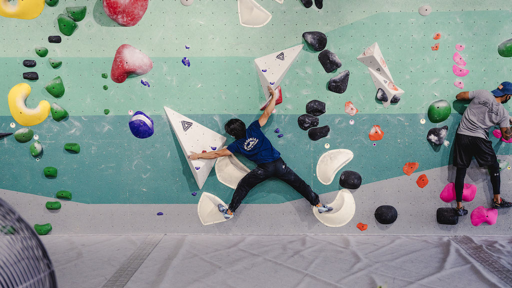 Bouldering 101 - members climbing slab wall