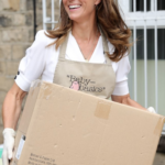 Kate Middleton in Floral Mask for Volunteering with Baby Basics