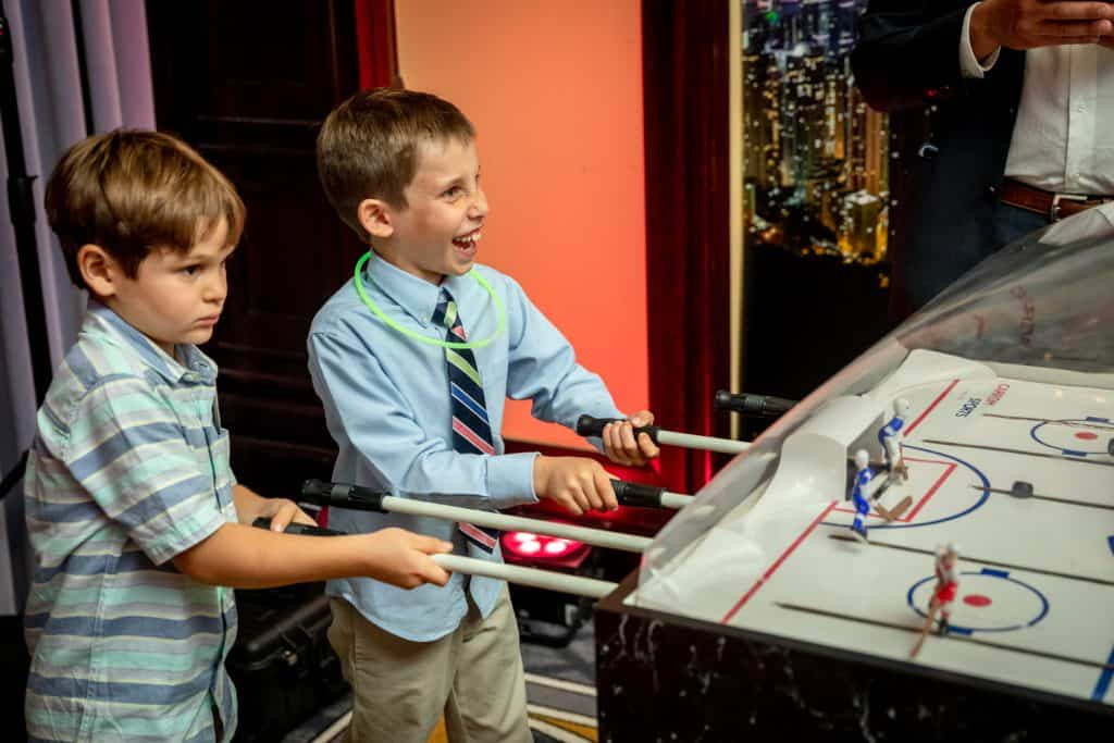 Bar Mitzvah Attendees Playing Air Hockey