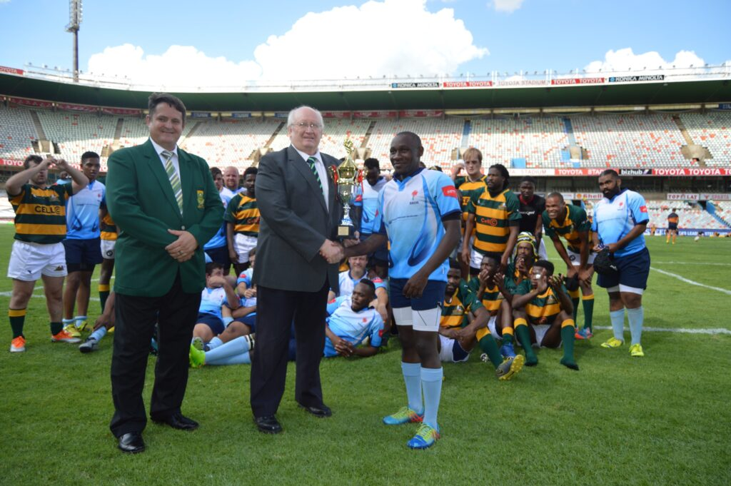 The 2019 Stones Cup is handed over to the captain of the Blue Bulls Deaf Rugby squad, Patrick Molotshwa