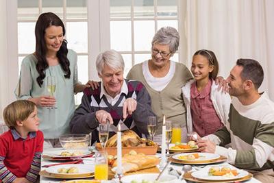 Multi-generational family eating