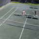Doubles Tennis hitting overhead