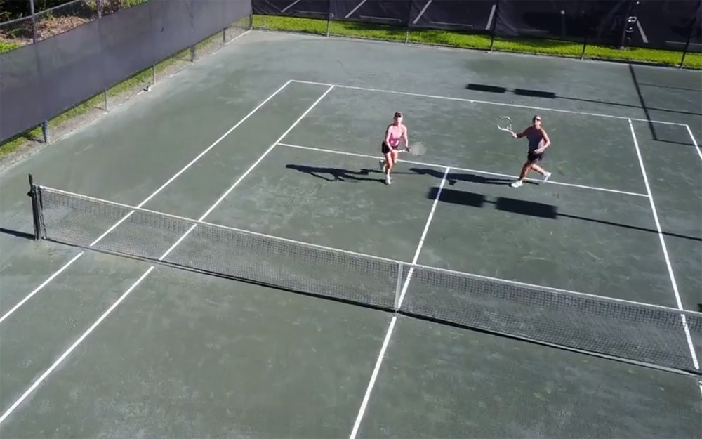 Doubles Tennis hitting overhead