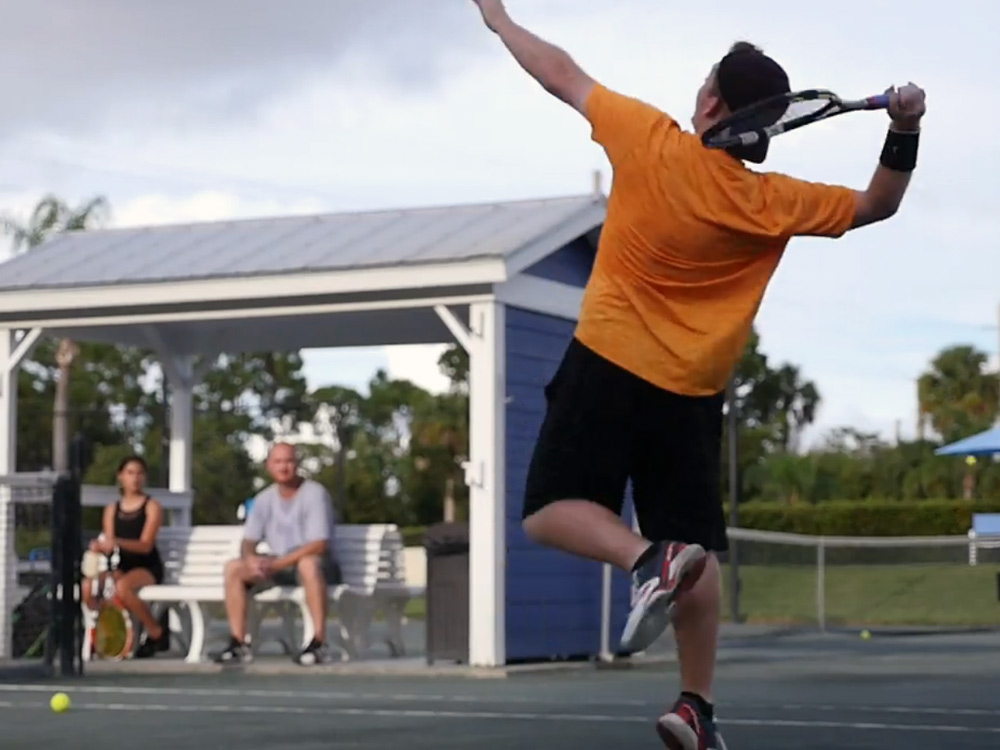 Junior Tennis Player in Stuart FL hitting overhead