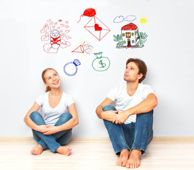 concept. young couple dreaming of new house, child, financial well-being