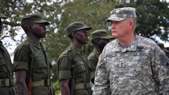 David Hogg, Commander of US Army Africa, inspects Ugandan troops in April 2011. Photo: U.S. Army. .