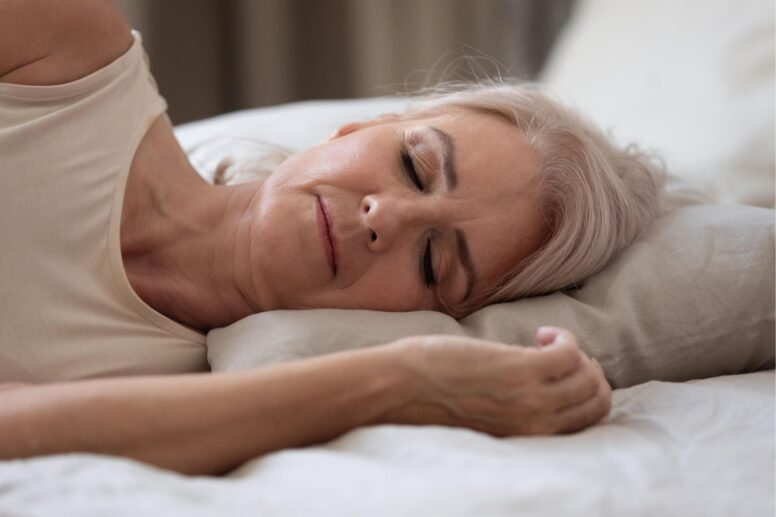 woman sleeping with herbs and supplements for insomnia