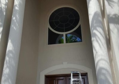 Exterior painting of two story residential entrance