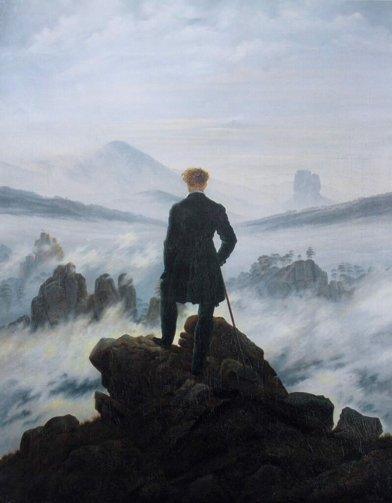 "Wanderer above the Sea of Fog is is by one of the great German Romantic artists, Caspar David Frederich. Some see it as representing the insignificance of a single man against the world, others as a metaphor for uncertainty about the future. I agree with both, but I really like it because a dear friend once described me as ""someone who sits on mountains and tries to make sense of what is going on down in the valley below."