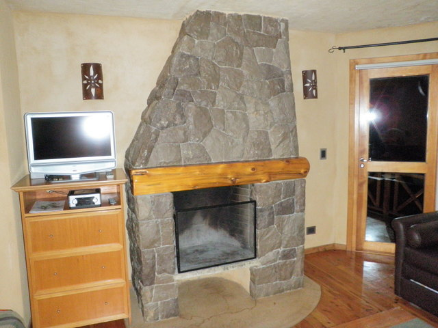 Fireplace in Our Room at Lirolay Suites in Bariloche