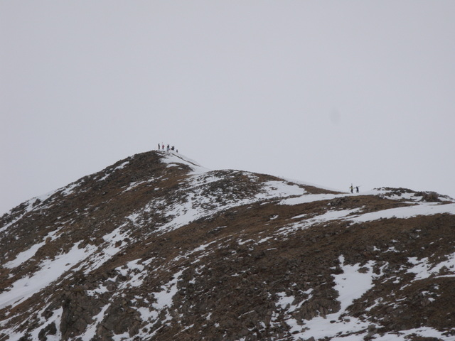 Skiers Hike to the Top of East Wall