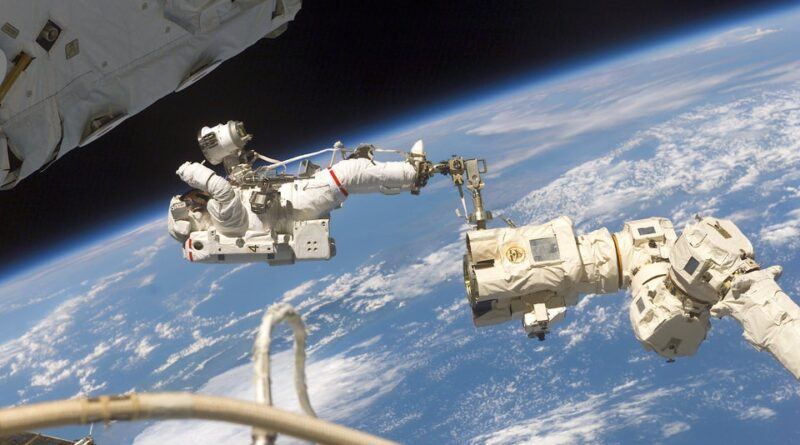 Jerry Ross Secured by foot restraint on Spacewalk