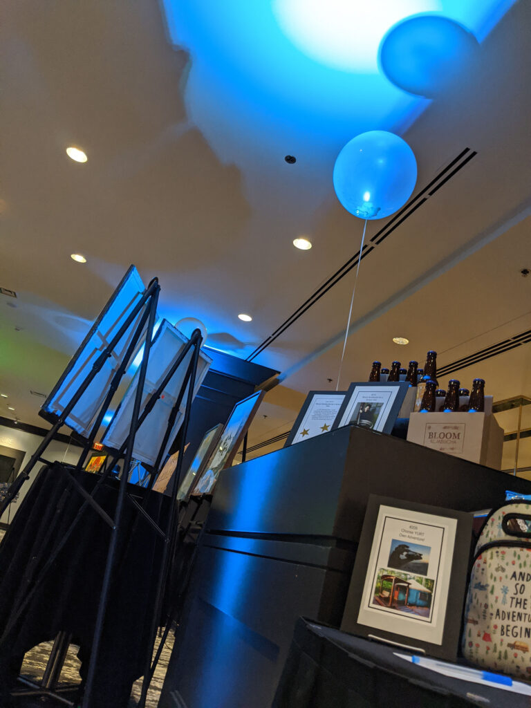 display of aution prizes lit with blue uplights