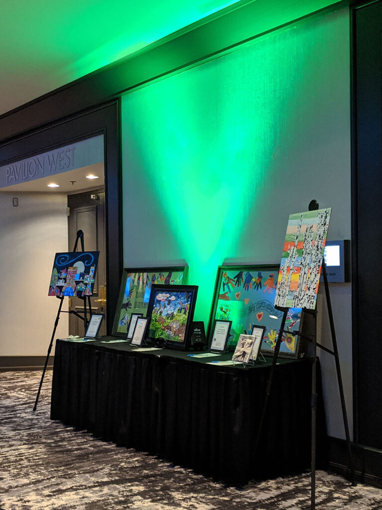 display of aution prizes lit with green uplights
