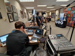 audiovisual technicians film and broadcast a livestreaming event