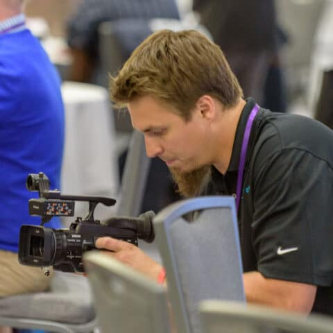 videographer films an event