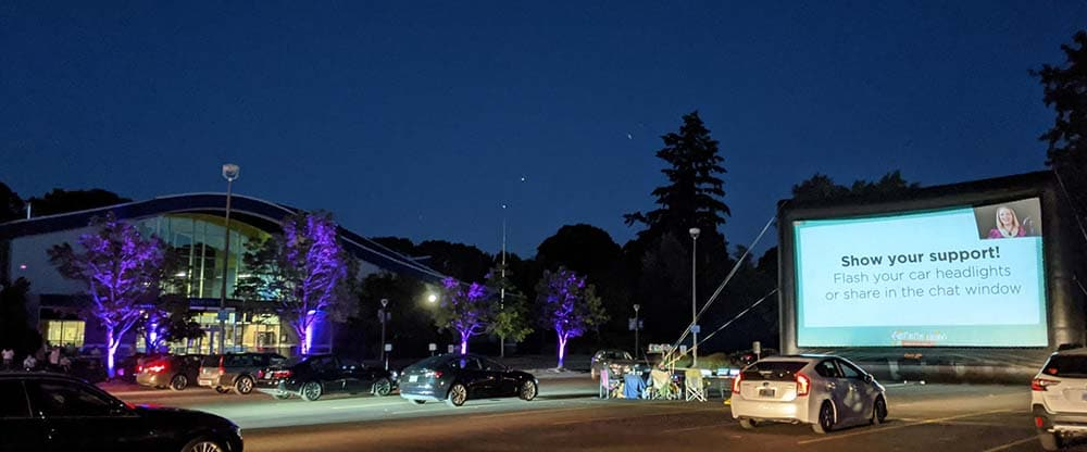guests in their cars attend a virtual drive-in gala fundraiser