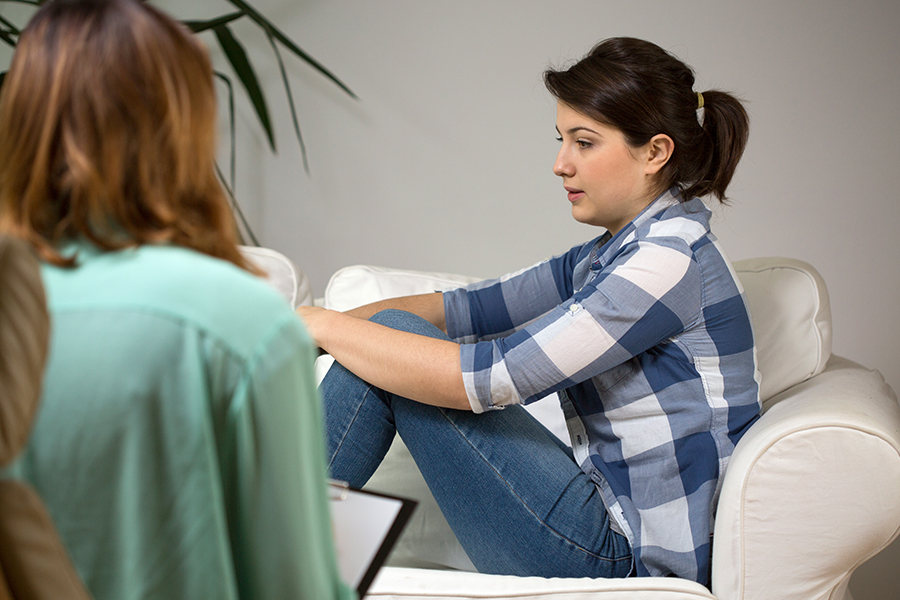 Women in Aura Holistic Psychotherapist Session