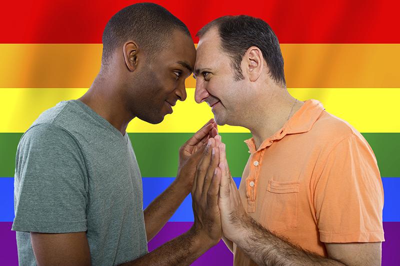Interracial Gay Couple with Rainbow Flag