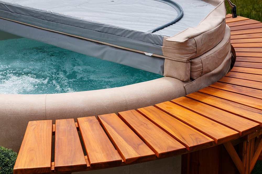 What should I use to clean my hot tub cover?