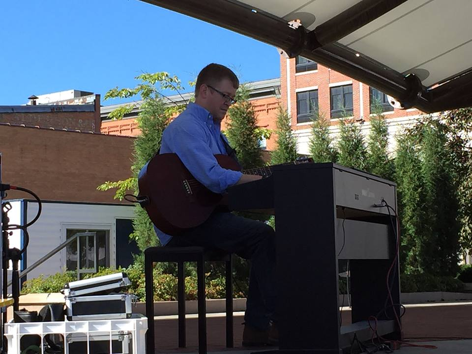 Jim Carlson plays piano at the Wausau Festival of Arts, 400 Block, Wausau, WI.