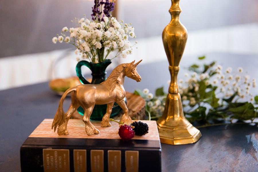 Gold unicorn wedding decor