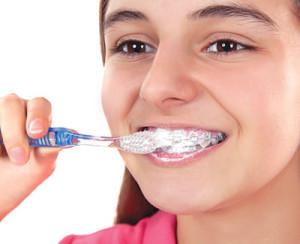 brushing-with-braces-300x244