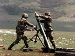 two army men loading a missile rocket gun