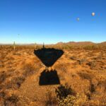 Hot Air Balloon Shadow Over the Desert